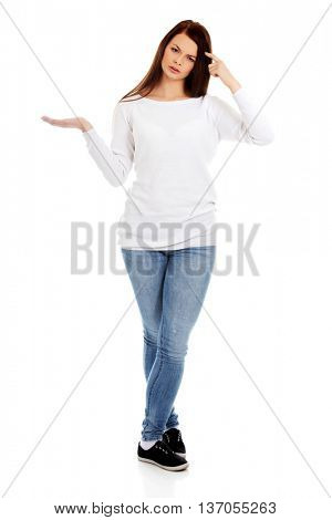 Young student woman holding something on open palm