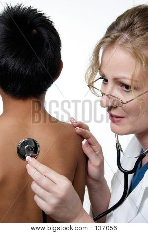 Child Having Physical And Medical Examination By Doctor