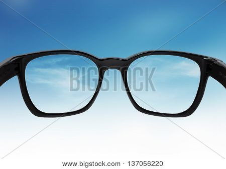 Glasses looking on blue sky, with out of focus and correct vision on lens