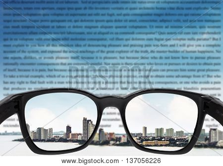 Glasses with city and sky and blurred vocabulary on sky