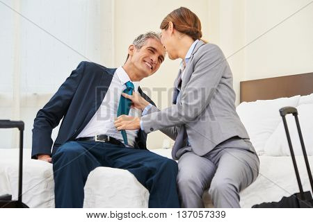 Two business people having an affair in a hotel room