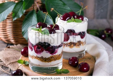 Dessert with a cherry and oat flakes in a glass