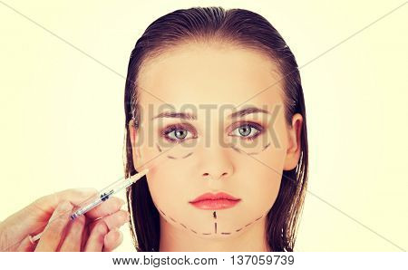 Cosmetic botox injection in the  face