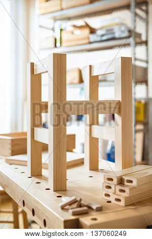 Stool making in woodwork workshop.