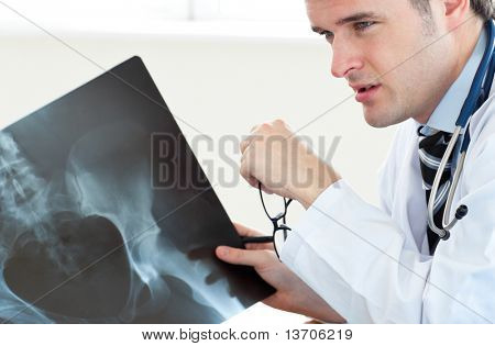 Attractive doctor at work against white background
