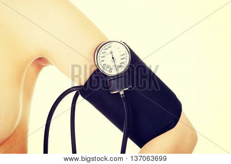 Female hand with blood-pressure meter
