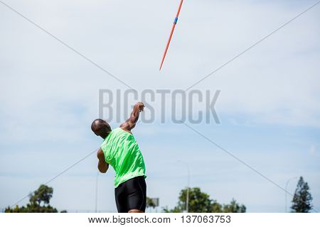 Rear view of athlete throwing a javelin