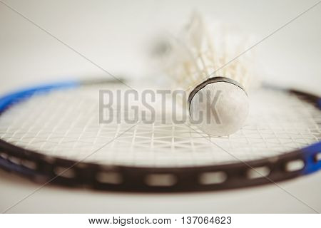 View of badminton racket and shuttlecock on white background
