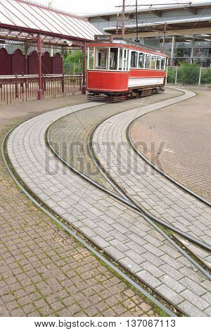 Red electric tramway with curved railways in Seaton, Devon