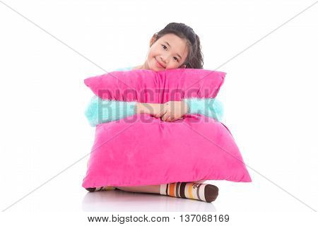 Beautiful asian girl with a big pink pillow on white background isolated