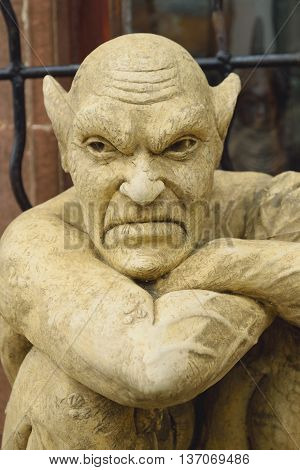 Closeup of gargoyle sculpture with big ears
