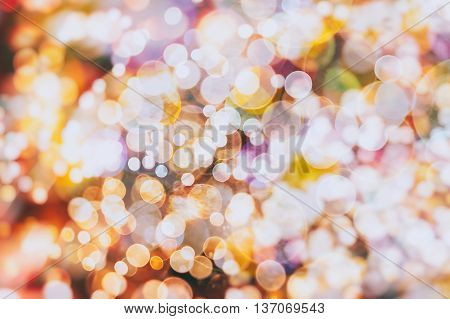 Defocused Bokeh twinkling lights vintage blurred bokeh abstract light spring forest background. Natural bokeh from leaf tree. Blur picture style.