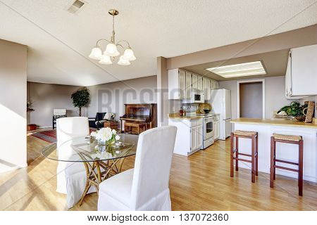 Dining Area Connected To Kitchen And Living Room