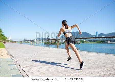 Woman running in a city of Hong Kong