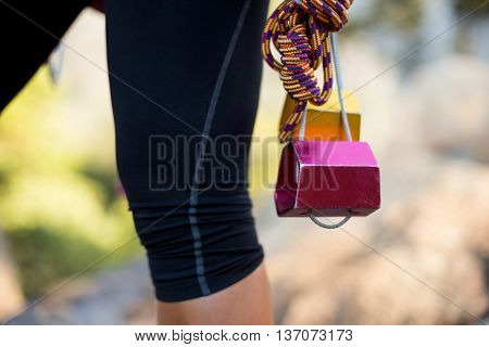 Close up climbing equipment on a woman