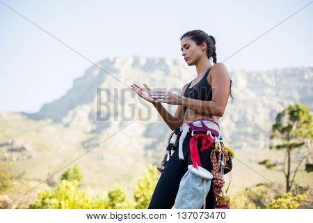 Woman preparing rock climbing on the wood