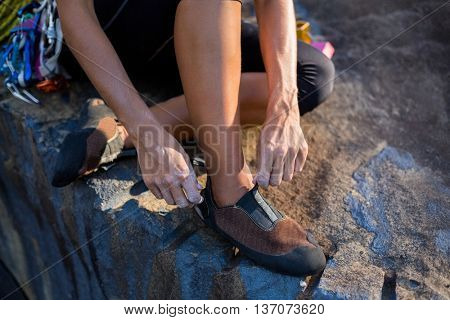 Close up of woman preparing rock climbing on the wood