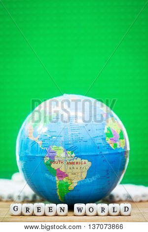 Globe - South America with GREEM WORLD Message from wood dice