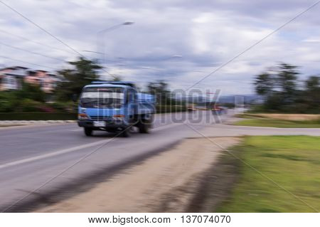 truck panning camera in road , asia