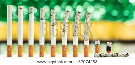 A montage of cigarettes during different stages of burn.