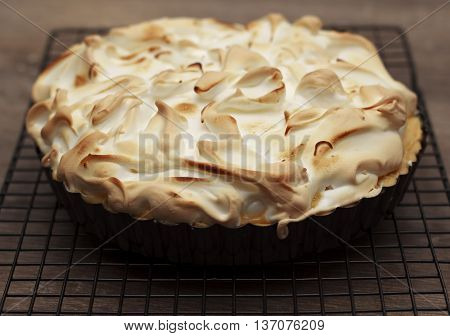 Lemon meringue pie on a cooling rack