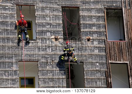 Bold And Daring Climbers Of Firefighters Climbing An House