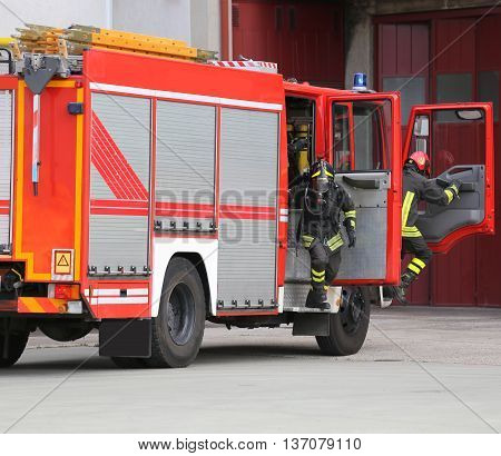 Fire Engine With Many Firefighters And Equipment For Fighting Fi