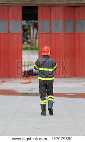 one Firefighters in uniform in the firehouse