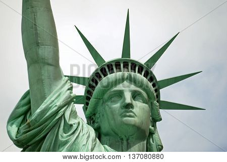 NEW YORK - JULY 2014: View of Statue of Liberty face on July 24,  2014 in Manhattan, NY. Statue of Liberty is one of the most recognizable landmark of New York City and one of the symbols of USA.