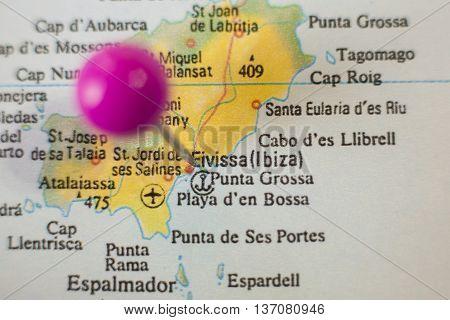 Pushpin marking on ibiza Spain. Selective focus on city