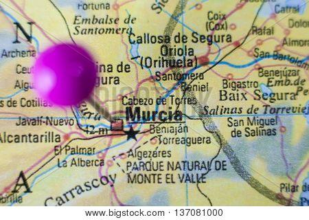 Pushpin marking on Murcia Spain. Selective focus on city