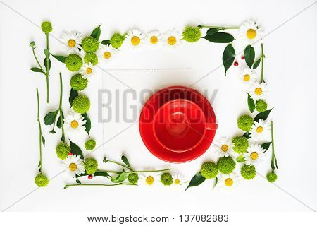 Paper And Red Cup For Coffee Or Tea With Wreath Frame.
