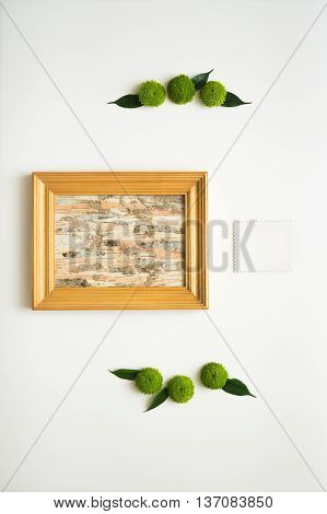 Wooden Frame With Collage Of Birch Bark And Paper.
