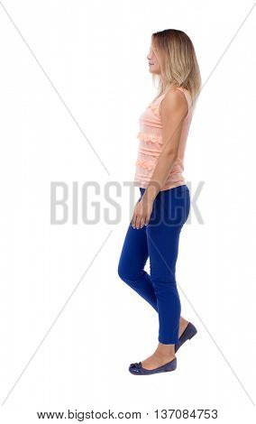 back view of walking  woman. beautiful blonde girl in motion.  backside view of person.  Rear view people collection. Isolated over white background. blonde in a pink jacket walking slowly to right
