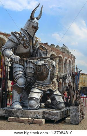 VERONA, ITALY - JULY, 2, 2016: sculpture of Gladiator infront of Arena of Verona (in Italian it is called Arena di Verona) - ancient amphitheatre used today as a stage for concerts and Opera