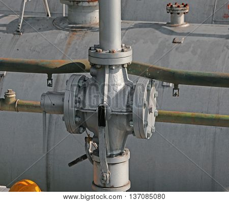 Large Pipes And Safety Valve Above The Gigantic Pressure Vessel