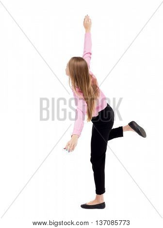 Balancing young business woman. dodge falling woman. Rear view people collection.  backside view of person. Isolated over white background. girl office worker in black trousers jumping on right foot