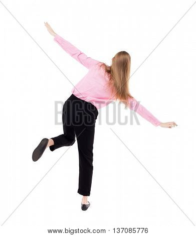 Balancing young business woman.  or dodge falling woman. Rear view people collection.  backside view of person.  Isolated over white background. The girl office worker in black trousers shows plane