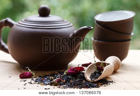 Fragrant Herbal Tea With Flower Petals, A Kettle And Cups On The Table. Selective Focus