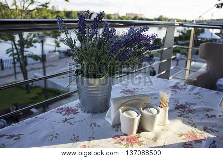Crockery on a table in a cafe on the summer terrace