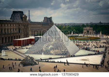 PARIS, FRANCE - MAY 13: Louvre pyramid closeup exterior view on May 13, 2015 in Paris. With over 60k sqM of exhibition space, Louvre is the biggest Museum in Paris.