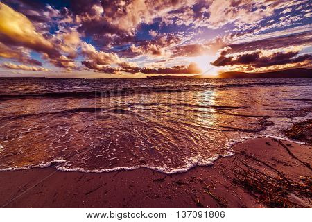 purple Alghero foreshore at sunset in Italy