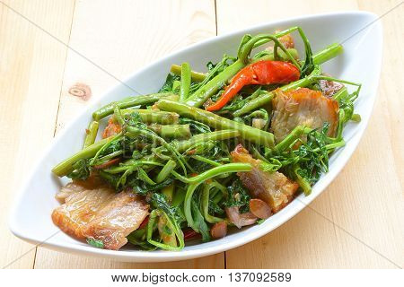 close up Fried Water minosa with crispy pork