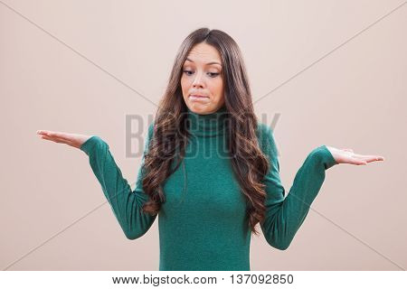 Portrait of young woman who is saying that she does not know