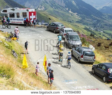 Col de la Croix de Fer France - 25 July 2015:Group of five cyclists climbing to the Col de la Croix de Fer in Alps during the stage 20 of Le Tour de France 2015.