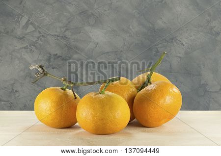 oranges on the wooden table on the loft texture background