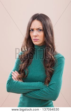 Studio shot portrait of displeased and offended woman.
