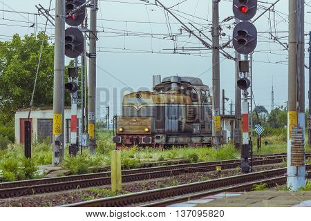 Caracal, Romania - June 19, 2016: Passenger train in station. Train of the National Railway Company (CFR). CFR  is the state railway carrier of Romania.