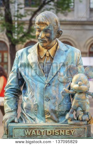 Bucharest, Romania - June 10, 2016: Walt Disney living statue at B-FIT in the Street. B-FIT is a cultural event that involves international artists and acrobats who act in theater plays on street.