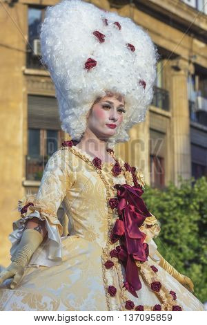 Bucharest Romania - June 10 2016: Ladies dressed in Baroque style at B-FIT in the Street. B-FIT is a cultural event that involves international artists and acrobats who act in theater plays on street.